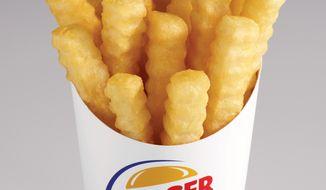 "Burger King says its new ""Satisfries"" (pictured) have 20 percent fewer calories than its regular fries. (AP Photo/Burger King, Noel Barnhurst)"