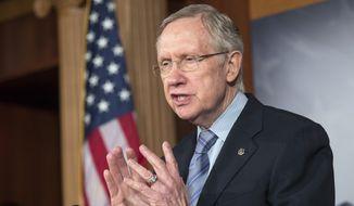 **FILE** Senate Majority Leader Harry Reid, Nevada Democrat, speaks Sept. 19, 2013, on Capitol Hill in Washington. (Associated Press)
