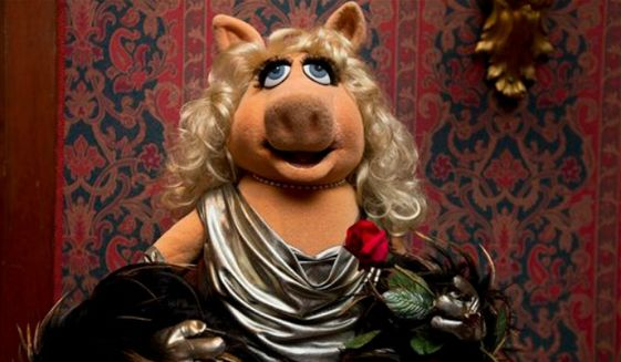 "A Miss Piggy muppet, that was used on ""The Muppet Show,"" is all dressed up during a ceremony to donate additional Jim Henson objects to the Smithsonian's National Museum of American History in Washington, Tuesday, Sept. 24, 2013. (Associated Press)"