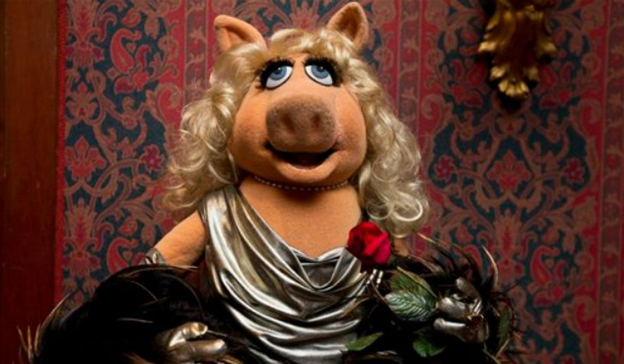 """A Miss Piggy muppet, that was used on """"The Muppet Show,"""" is all dressed up during a ceremony to donate additional Jim Henson objects to the Smithsonian's National Museum of American History in Washington, Tuesday, Sept. 24, 2013. (Associated Press)"""