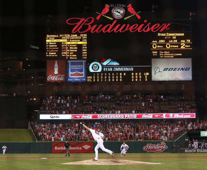 St. Louis Cardinals pitcher Michael Wacha reaches for Ryan Zimmerman's chopper in the ninth inning Tuesday night. Wacha was one out from a no-hitter when Zimmerman reached on an infield single that hit off Wacha's glove. (Associated Press photo)