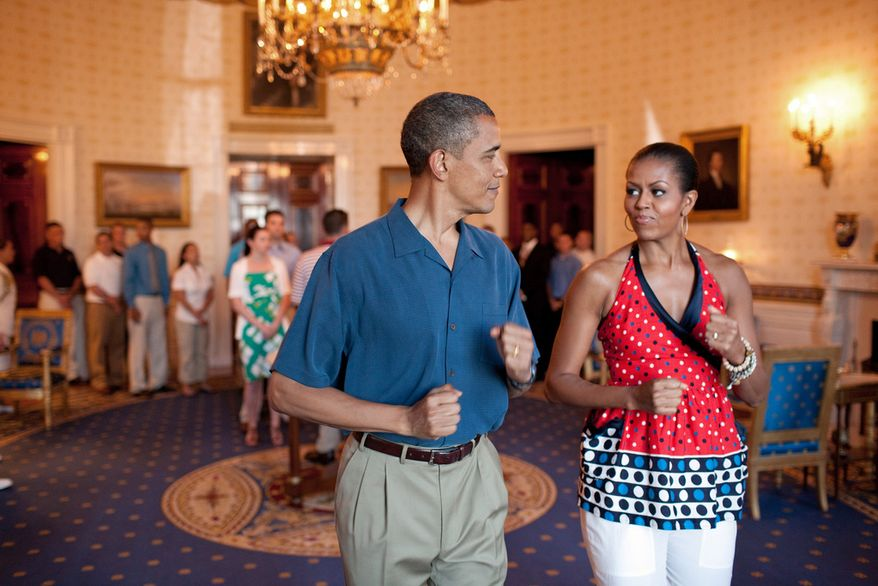 President Barack Obama and First Lady Michelle Obama pretend to march to music in the Blue Room of the White House, July 4, 2010, before delivering remarks to military families during a Fourth of July celebration. (Official White House Photo by Pete Souza)