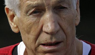 **FILE** Former Penn State University assistant football coach Jerry Sandusky leaves the Centre County Courthouse in Bellefonte, Pa., on Oct. 9, 2012, after being sentenced to a 30- to 60-year state prison sentence for sexual abuse of 10 boys. (Associated Press)