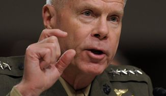 "Gen. James Amos, commandant of the Marine Corps, ordered the general overseeing all desecration cases to ""crush"" the defendants, who included Capt. James V. Clement. (Associated Press)"