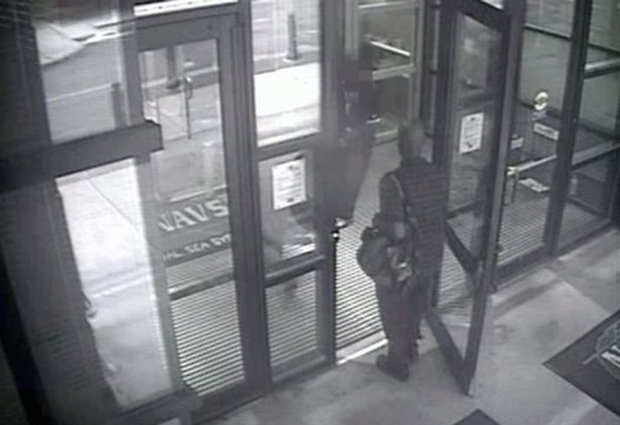 This image from video provided by the FBI, shows Aaron Alexis enters Building 197 at the Navy Yard at 8:08 a.m., on Monday, Sept. 16. Alexis, a 34-year-old ex-Navy reservist and IT contractor, fatally shot 12 people inside the Washington Navy Yard building. (FBI via associated press)