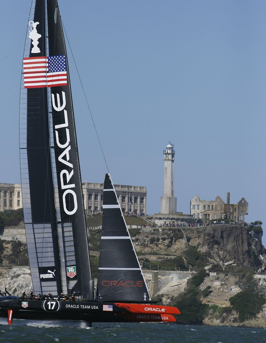 Oracle Team USA sails past Alcatraz Island during the 18th race of the America's Cup sailing event against Emirates Team New Zealand Tuesday, Sept. 24, 2013, in San Francisco. (AP Photo/Ben Margot)