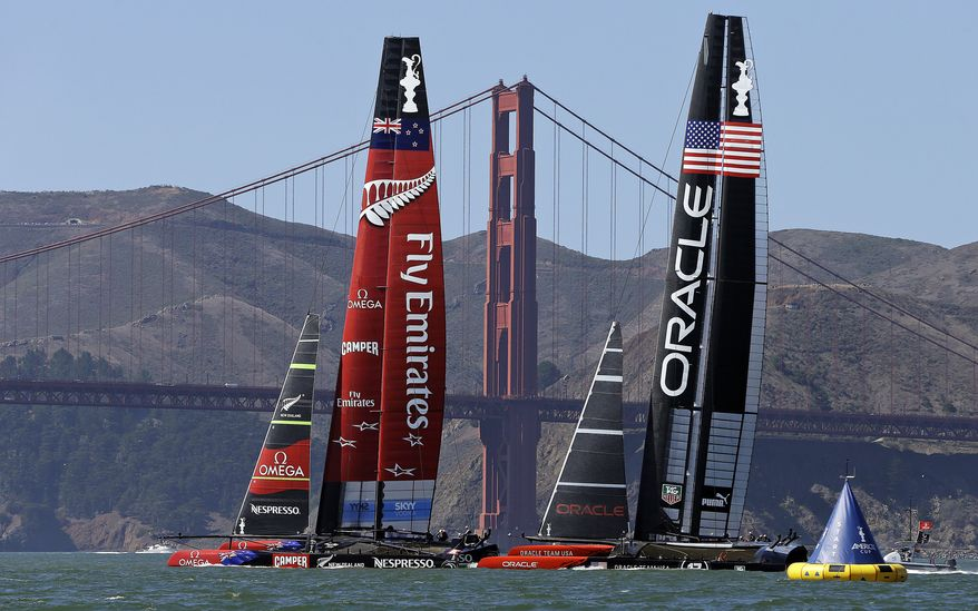 Emirates Team New Zealand, left, and Oracle Team USA line up in the starting box for the 17th race of the America's Cup sailing event against Tuesday, Sept. 24, 2013, in San Francisco. Oracle Team USA won races 17 and 18 to pull even with Emirates Team New Zealand. (AP Photo/Ben Margot)