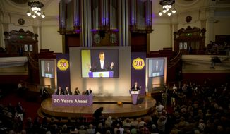 Nigel Farage (at right on the podium), the leader of the U.K. Independence Party, speaks during the party's annual conference at Central Hall Westminster in London on Friday, Sept. 20, 2013. UKIP, which says it is aiming for first place in the 2014 European Parliament elections, was founded in 1993 to campaign for the United Kingdom's withdrawal from the European Union. (AP Photo/Matt Dunham)
