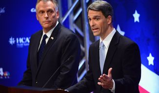 Virginia gubernatorial candidates Democrat Terry McAuliffe, left, listens as Republican Attorney General Ken Cuccinelli speaks at a Fairfax County Chamber of Commerce debate Wednesday, Sept. 25, 2013, in McLean, Va. (AP Photo/The Washington Post, Linda Davidson, Pool)