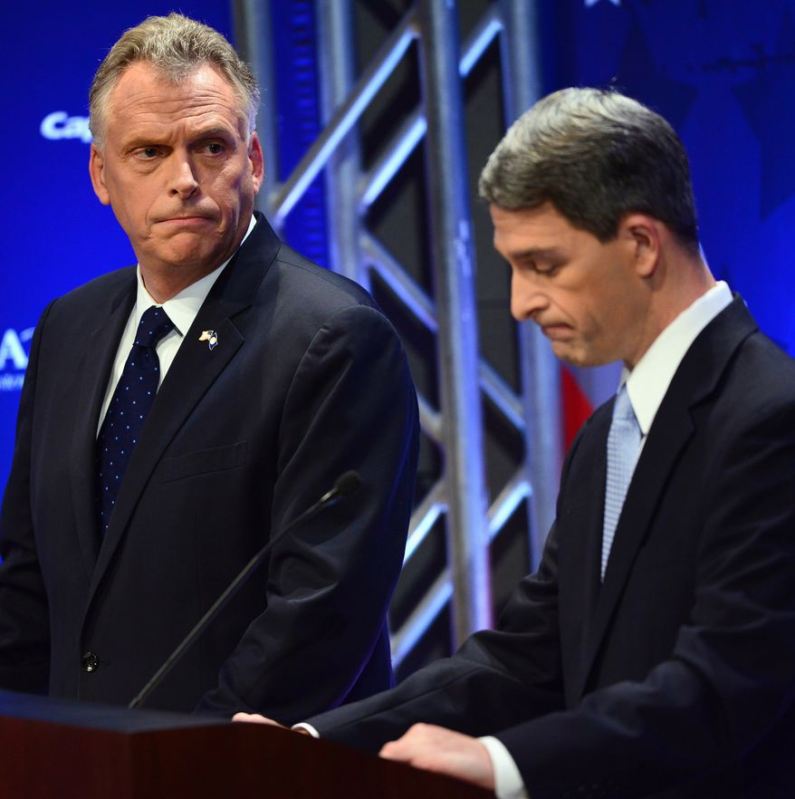 Virginia gubernatorial candidates Democrat Terry McAuliffe, left, watches as Republican Attorney General Ken Cuccinelli pauses at a Fairfax County Chamber of Commerce debate Wednesday, Sept. 25, 2013, in McLean, Va. (AP Photo/The Washington Post, Linda Davidson, Pool)