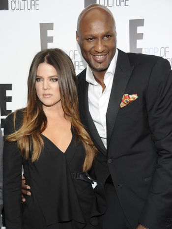 """** FILE ** In this April 30, 2012, file photo, Khloe Kardashian Odom and Lamar Odom pose at an E! Network event in New York. Odom is breaking his silence with his first post on Twitter since the NBA star was arrested and charged with driving under the influence last month. Odom tweeted """"Seeing the snakes"""" on Tuesday night, Sept. 24, 2013, in his first post since his Aug. 30 arrest. (AP Photo/Evan Agostini, File)"""