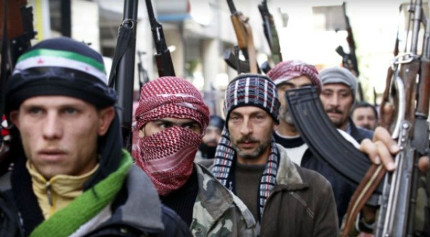 ** FILE ** Syrian rebels take up position in Idlib, Syria, Feb. 10, 2012. (Associated Press)