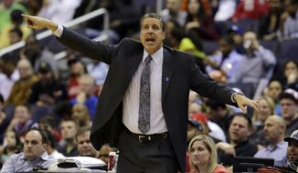 """FILE - In this April 2, 2013 file photo, Washington Wizards head coach Randy Wittman directs his team in the first half of an NBA basketball game against the Chicago Bulls in Washington. The aim is pretty clear for Wall and the rest of the Washington Wizards: get to the postseason. Team president Ernie Grunfeld says so. As does coach Randy Wittman. Speaking at a joint news conference Wednesday, Grunfeld says, """"Our initial goal is to be a playoff contender and, ultimately, by the end of the year, make the playoffs."""" Wittman adds, """"We want to make the playoffs. ... And there's no reason why we can't.""""  Washington went 29-53 last season, missing out on the postseason for the fifth consecutive year.(AP Photo/Alex Brandon, File)"""