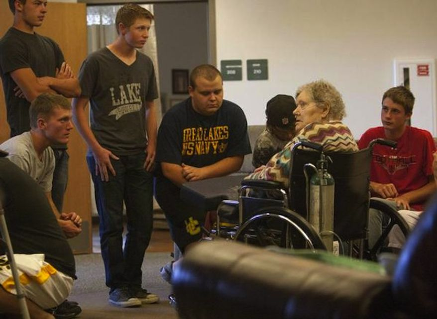 Union football players put in service time at the Uintah Basin Rehabilitation and Senior Villa in Roosevelt, Utah, on Sept. 24, 2013. The football coaches at Union High School have taken a stand against poor performance in the classroom and bullying outside the classroom, including disrespect of teachers and students. (Scott G. Winterton/Deseret News)