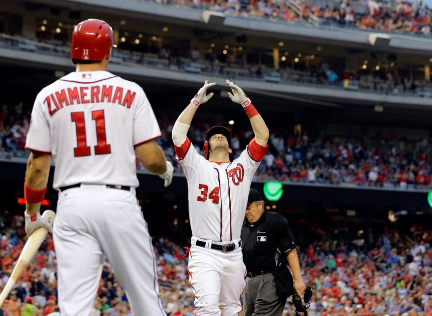 """Faithful: The Nationals' Bryce Harper (34), the only Mormon on the team, writes on every autograph he signs, """"Luke 1:37,"""" """"For with God, nothing shall be impossible."""" He enjoys listening to his teammates debate their own religious views. (Associated Press)"""