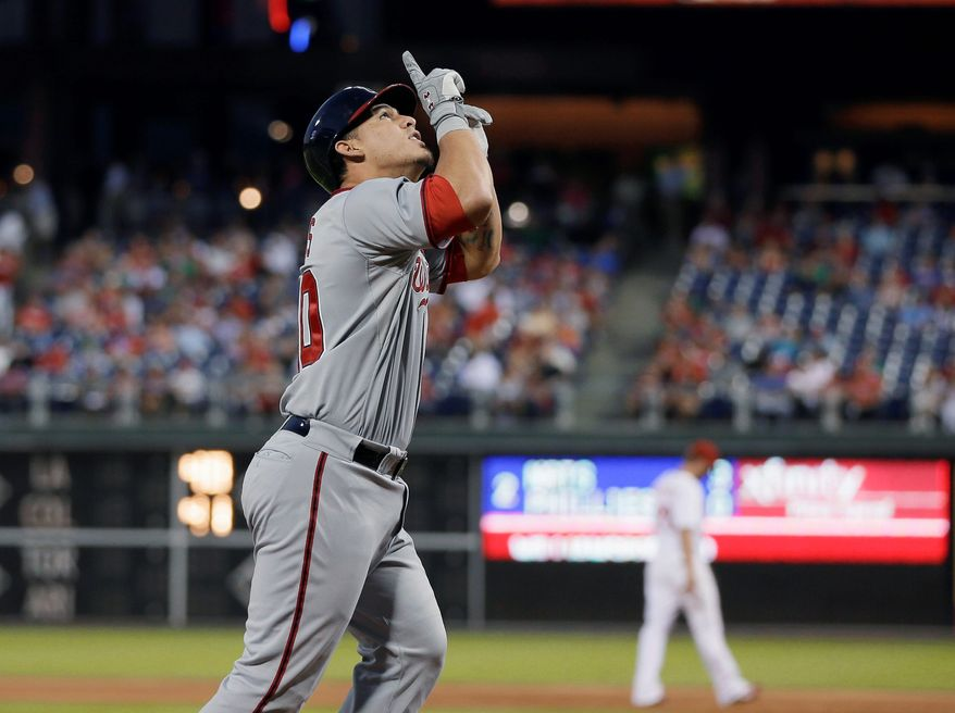 Washington Nationals' Wilson Ramos gestures as he crosses home plate after hitting a three-run homer. Multiple players, regardless of whether they were actively religious or not, said they never had been on a team that talks about religion as much as this one. (Associated Press)