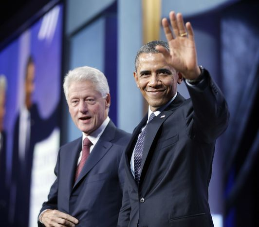 **FILE** President Obama (right) waves to members of the audience after speaking at the Clinton Global Initiative with former President Bill Clinton in New York on Sept. 24, 2013. (Associated Press)