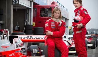 "Chris Hemsworth, left, and Daniel Bruhl in a scene from ""Rush."" (AP Photo/Universal Pictures, Jaap Buitendijk)"