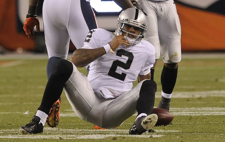 Oakland Raiders quarterback Terrelle Pryor (2) gets up off the turf after being sacked by the Denver Broncos in the third quarter of an NFL football game, Monday, Sept. 23, 2013, in Denver. (AP Photo/Jack Dempsey)