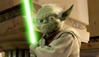 ** FILE ** Jedi Master Yoda wields a lightsaber. (Associated Press)