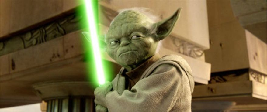 ** FILE ** Jedi Master Yoda wields a lightsaber. (Associated Press)