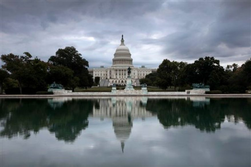 Storm clouds hang over Capitol Hill in Washington, Friday, Sept. 27, 2013, as the Republican-controlled House and the Democrat-controlled Senate stand at an impasse with Congress continuing to struggle over how to fund the government and prevent a possible shutdown. (AP Photo/J. Scott Applewhite)