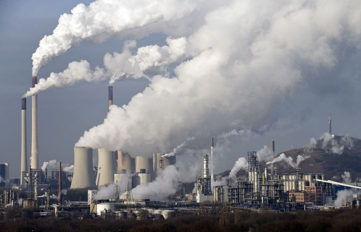 ** FILE ** In this Dec. 16, 2009, file photo, steam and smoke rises from a coal power station in Gelsenkirchen, Germany. Scientists are more confident than ever that pumping carbon dioxide into the air by burning fossil fuels is warming the planet. By how much is something governments and scientists meeting in Stockholm will try to pin down with as much precision as possible Friday, Sept. 27, 2013, in a seminal report on global warming. (AP Photo/Martin Meissner, File)