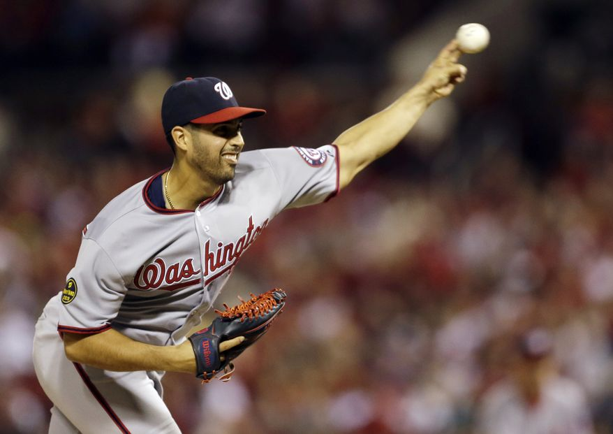 Washington Nationals starting pitcher Gio Gonzalez throws against the St. Louis Cardinals during the fourth inning of a baseball game on Tuesday, Sept. 24, 2013, in St. Louis. (AP Photo/Jeff Roberson)