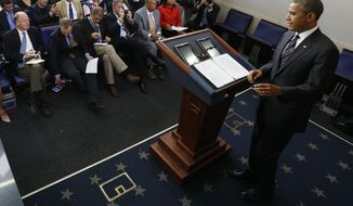 President Obama arrives to make a statement regarding the budget fight in Congress and foreign policy challenges in the James Brady Press Briefing Room at the White House in Washington on Sept. 27, 2013. (Associated Press)