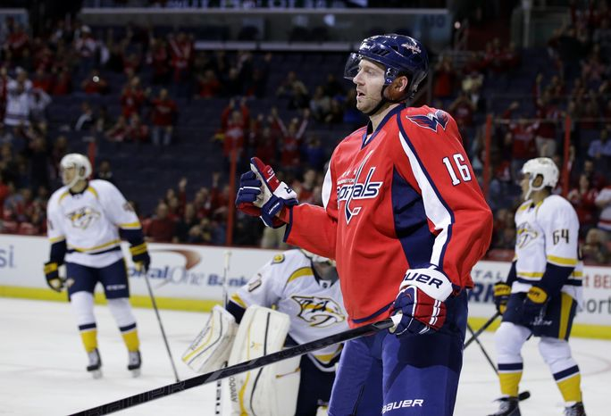 Washington Capitals right wing Eric Fehr (16) celebrates after his goal in the first period of a preseason NHL hockey game against the Nashville Predators, Wednesday, Sept. 25, 2013, in Washington. (AP Photo/Alex Brandon)