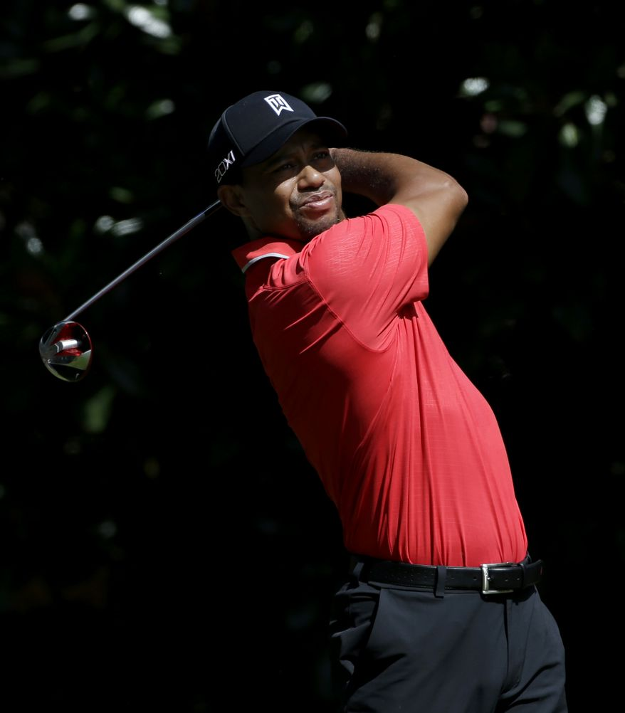 Tiger Woods tees off the fourth hole during the final round of play in the Tour Championship golf tournament at East Lake Golf Club, in Atlanta, Sunday, Sept. 22, 2013. (AP Photo/John Bazemore)