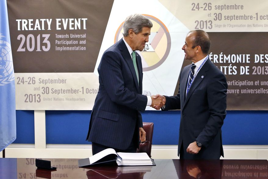 U.S. Secretary of State John Kerry, left, shakes hands with Under Secretary-General for Legal Affairs Miguel Serpa Soares after signing the Arms Trade Treaty during the 68th session of the United Nations General Assembly at U.N. headquarters, Wednesday, Sept. 25, 2013. (AP Photo/Jason DeCrow)