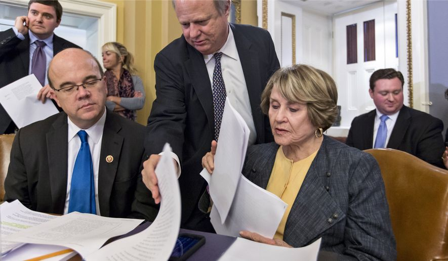 In this Sept. 28, 2013 photo, House Rules Committee Ranking Member Louise Slaughter, D-N.Y., right, and Rep. James P. McGovern, D-Mass., left, examine the wording of the continuing appropriations resolution bill as the panel meets to hear amendments. (AP Photo/J. Scott Applewhite)