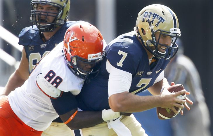 Virginia defensive end Max Valles (88) sacks Pittsburgh quarterback Tom Savage (7) in the second quarter of an NCAA football game Saturday, Sept. 28, 2013 in Pittsburgh. (AP Photo/Keith Srakocic)