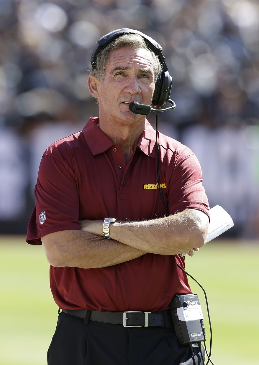 Washington Redskins head coach Mike Shanahan walks on the sideline during the first quarter of an NFL football game against the Oakland Raiders in Oakland, Calif., Sunday, Sept. 29, 2013. (AP Photo/Ben Margot)