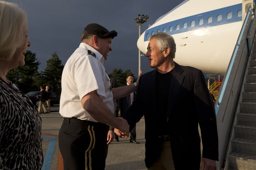 Secretary of Defense Chuck Hagel (right) is greeted by U.S. Forces Korea Commanding Gen. James Thurman upon arrival in Seoul on Sunday, Sept. 29, 2013. Mr. Hagel is expected to spend four days in South Korea for celebrations marking the 60th anniversary of the ending of the Korean War before heading to Japan for ministerial meetings. (AP Photo/Jacquelyn Martin, Pool)