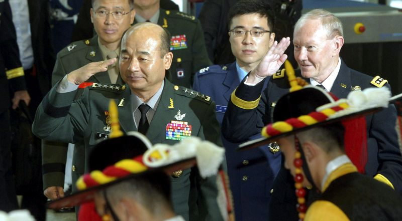 ** FILE ** U.S. Army Gen. Martin Dempsey, the chairman of the Joint Chiefs of Staff, right, and his South Korean counterpart Gen. Jung Seung-jo, left, salute as they inspect members of an honor guard upon arriving for the Military Committee Meeting (MCM) at the Defense Ministry in Seoul, South Korea, Monday, Sept. 30, 2013. (AP Photo/Korea Pool via Yonhap)