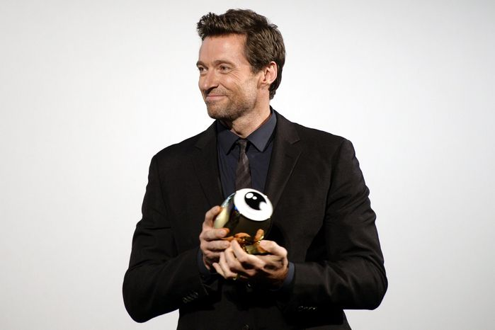 In this picture made available Sunday, Sept. 29, 2013, Australian actor Hugh Jackman receives the Golden Icon Award during the 9th annual Zurich Film Festival in Zurich, Switzerland, on Saturday, Sept. 28, 2013. (AP Photo/Keystone, Walter Bieri)