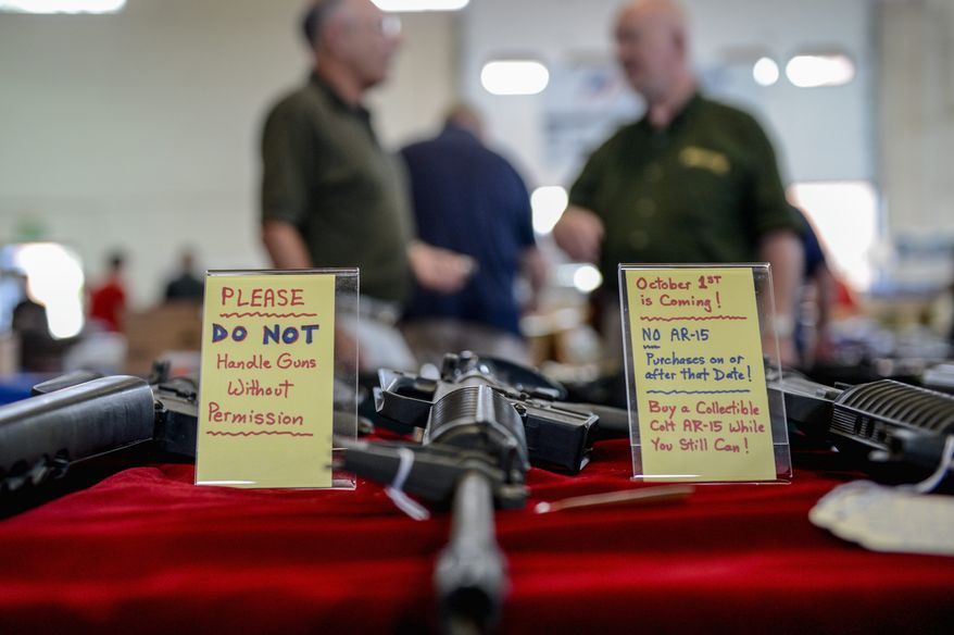 A sign warning of the coming assault-weapons ban in Maryland was on display next to AR-15 semi-automatic rifles at a gun show recently in Annapolis. The bill, signed into law by Maryland Gov. Martin O'Malley (below) on May 16, was set to take effect Tuesday pending foes' pursuit of a federal court injunction. (photographs by andrew harnik/the Washington Times)