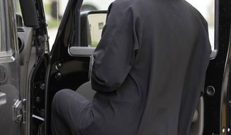 **FILE** A woman gets into a car in Riyadh, Saudi Arabia, on May 24, 2011. (Associated Press)