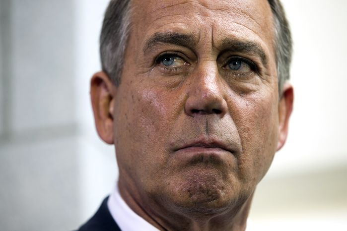 ** FILE ** Speaker of the House John Boehner, R- Ohio, pauses during a news conference after a House Republican Conference meeting about the ongoing budget fight on Capitol Hill on Monday, Sept. 30, 2013, in Washington.  (AP Photo/ Evan Vucci)
