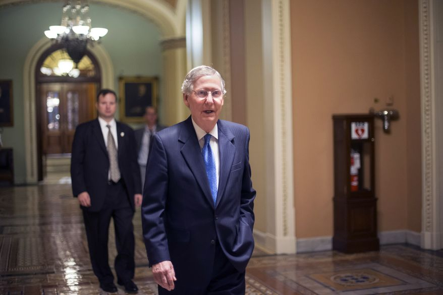Senate Minority Leader Mitch McConnell, R-Ky., leaves the Senate Chamber after lawmakers once again rejected the House version of the government funding bill, Monday night, Sept. 30, 2013, in Washington. The Republican-controlled House and the Democrat-controlled Senate are at an impasse as Congress continues to struggle over how to prevent a possible shutdown of the federal government when it runs out of money. (AP Photo/J. Scott Applewhite)
