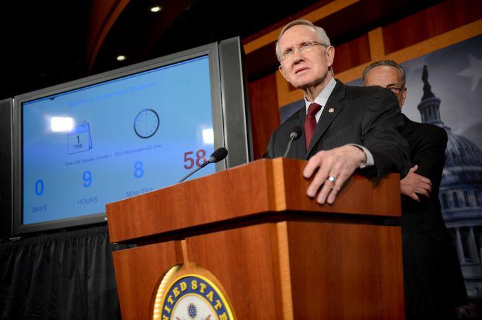 ** FILE ** Senate Majority Leader Harry Reid, Nevada Democrat, at the U.S. Capitol Building, Washington, D.C., Monday, Sept. 30, 2013. (Andrew Harnik/The Washington Times)
