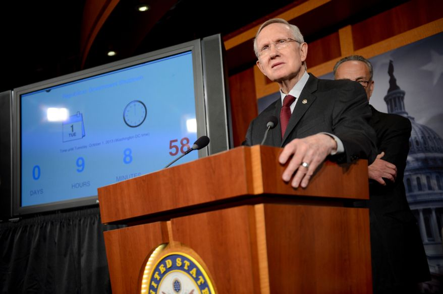 ** FILE ** Senate Majority Leader Harry Reid, Nevada Democrat, at the U.S. Capitol Building, Washington, D.C., Monday, Sept. 30, 2013. (Andrew Harnik/The Washington Times)