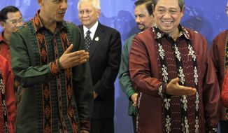 **FILE** President Obama walks with Indonesian President Susilo Bambang Yudhoyono after a family photo before the East Asia Summit Gala dinner in Nusa Dua, on the island of Bali, Indonesia, on Nov. 18, 2011. (Associated Press)