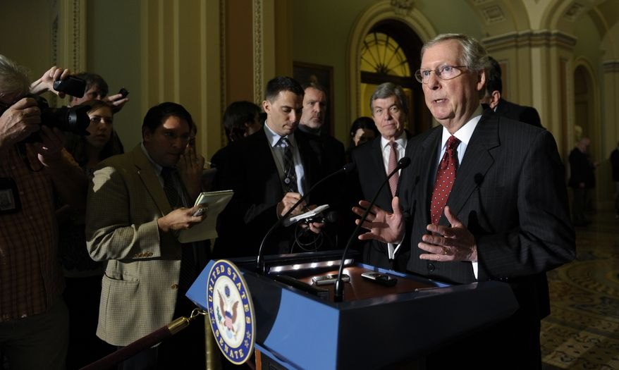 ** FILE ** Senate Minority Leader Mitch McConnell of Ky., right, speaks to reporters following a policy luncheon on Capitol Hill in Washington, Tuesday, Oct. 1, 2013. Lawmakers on Capitol Hill continue to scramble to reach agreement on funding the federal government.  (AP Photo/Susan Walsh)