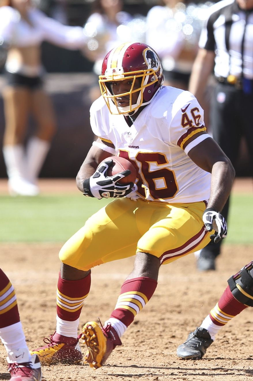 Washington Redskins' Alfred Morris (46) runs the ball against the Oakland Raiders in the first quarter at an NFL game in Oakland, California at the O.CO Coliseum on Sunday, Sept. 29, 2013. (AP Photo/David Seelig)