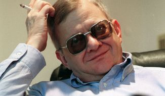 FILE - In this Feb. 4, 1998 file photo, writer Tom Clancy appears at his home in Calvert County, Md. Clancy, the estselling author of more than 25 fiction and nonfiction books for the Penguin Group, died on Oct. 1, 2013 in Baltimore, Md. He was 66.  (AP Photo/Vince Lupo)