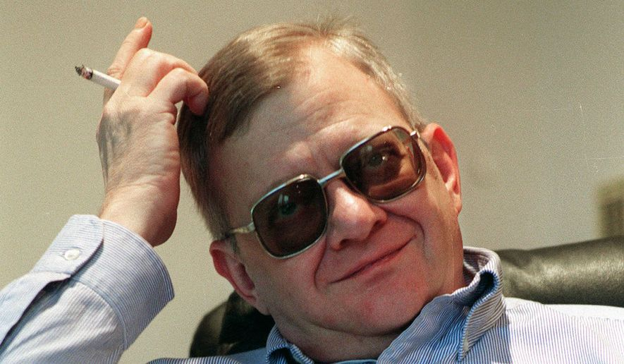 In this Feb. 4, 1998, file photo, writer Tom Clancy appears at his home in Calvert County, Md. Clancy, the bestselling author of more than 25 fiction and nonfiction books for the Penguin Group, died on Oct. 1, 2013, in Baltimore, Md. He was 66. (AP Photo/Vince Lupo)