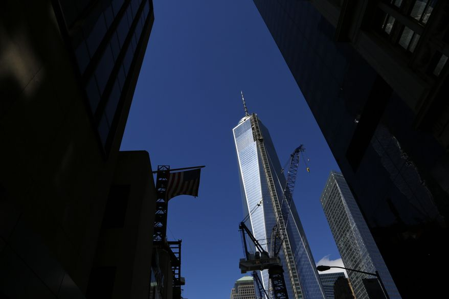 ** FILE ** In this Sunday, Sept. 22, 2013, photo, One World Trade Center, a skyscraper built at the site of the 9/11 attacks on the World Trade Center is seen in New York. Soaring above the city at 1,776 feet, 104-story One World Trade Center, is America's tallest building and includes office space, an observation deck and restaurants. It is expected to be open in 2014. (AP Photo/Lefteris Pitarakis)